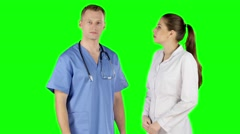 Two young doctors talking together. Green screen Stock Footage