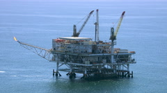 Aerial shot of off shore oil platform - stock footage