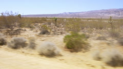 Taking off and flying over California desert Stock Footage