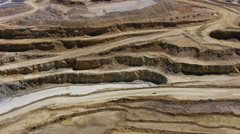 Aerial shot of truck driving through quarry Stock Footage