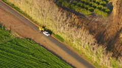 Aerial shot of pickup truck hauling farm machinery Stock Footage
