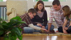 Family at home playing game together Stock Footage