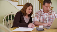 Couple doing taxes Stock Footage