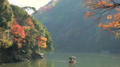 River boat & autumn colour Stock Footage