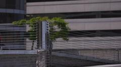 Businessman jumping over parking garage barrier Stock Footage
