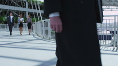 Business workers walking through airport Stock Footage