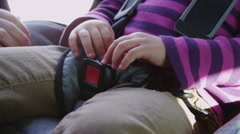 Attaching car seat buckle, closeup Stock Footage