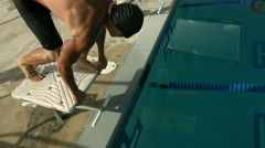 Swimmer dives from starting block, super slow motion Stock Footage