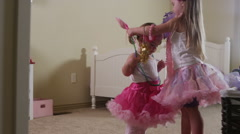 Two young girls play dress up Stock Footage
