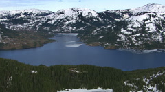 Flying over forest and lake in Alaska Stock Footage