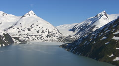 Aerial shot of glacier and mountain peaks, Alaska - stock footage