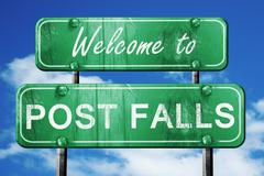 post falls vintage green road sign with blue sky background - stock illustration