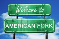 american fork vintage green road sign with blue sky background - stock illustration