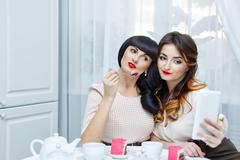 Girlfriends make selfie. Tea party. - stock photo