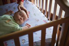 Baby in crib Stock Photos