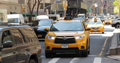 New York City yellow cabs cars on Park Avenue driving Stock Footage