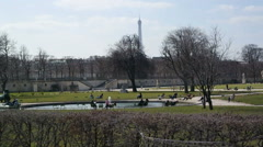 Tourists in beautiful park in Paris, France. Stock Footage