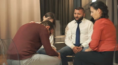 People during therapy with psychologist, sad man crying Stock Footage
