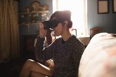 Young woman using the virtual reality headset Stock Photos