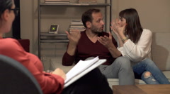 Young couple fighting during therapy with psychologist Stock Footage