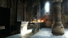 Armenian apostolic church. Light falling inside the Geghard monastery Stock Footage