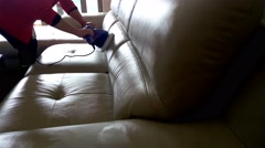 Cleaning leather sofa at home with sound Stock Footage