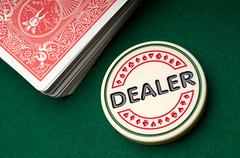 Gambling chip and playing cards - stock photo