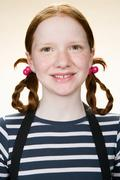 Portrait of a girl with pigtails - stock photo