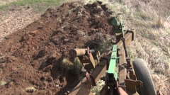 Earth plowing with old tractor Stock Footage