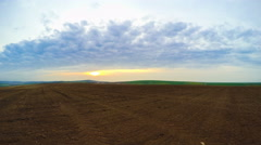 Ploughed Land and Clouds. Panorama. Time Lapse Stock Footage