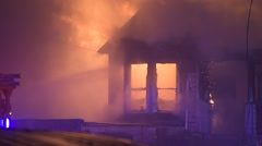 Firefighters Responding To A House Engulfed In Flames 1 Stock Footage