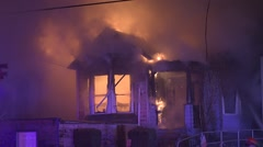 Firefighters Responding To A House Engulfed In Flames 4 Stock Footage