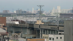 Bullet train passing through city - stock footage