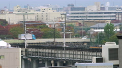 Bullet train passing through city Stock Footage