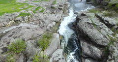 Mountain river flowing through the canyon aerial view Stock Footage