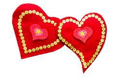 A pair of loving hearts handmade from felt isolated Stock Photos