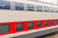 A two-story long-distance passenger train closeup Stock Photos