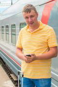 portrait of a man on a journey on the train - stock photo