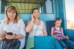 Three passengers of all ages in the train light metro Kuvituskuvat