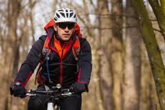 Mountain Bike cyclist riding single track - stock photo