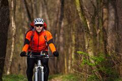 Mountain Bike cyclist riding single track Stock Photos