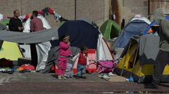 EDITORIAL:  Little children playing in a refugee camp Stock Footage