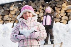 Young girls having fun in the snow Stock Photos