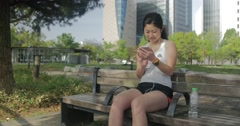 Japanese young women in fitness clothes answers text messages from friends - stock footage