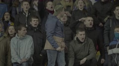 Group of football fans in the stadium shouting slogans Stock Footage