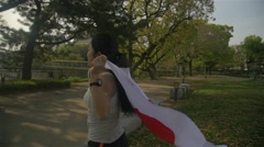 Japanese young fitness girl running with Japanese flag feeling inspired Slowm Stock Footage