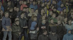 Football fans singing the song during the match Arkistovideo