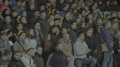 Group of football fans chanting slogans at the stadium - stock footage