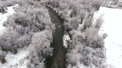Aerial shot of beautiful snowy river and trees Stock Footage