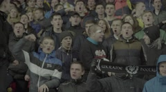 A group of football fans supporting their team - stock footage